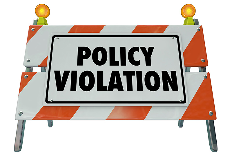 "construction sign that reads, ""Policy Violation"""