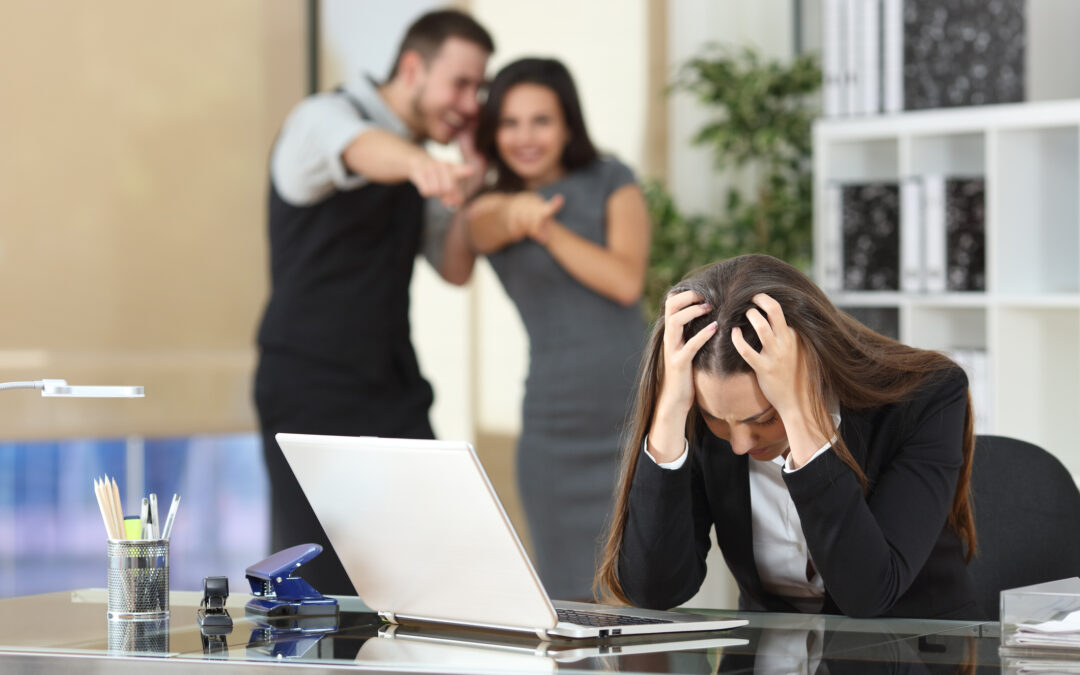 Businesspeople bullying a colleague at office